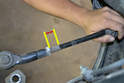 Measure and mark installation position of outer tie rod end (yellow arrows).