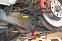 The rear drop link attaches to the stabilizer bar behind and below the trailing arm (red arrow) and attaches to the wheel bearing carrier at the top of the trailing arm (yellow arrow).
