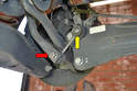 This photo illustrates where the link connects to the lower section of the stabilizer bar (red arrow) and the upper section of the trailing arm (yellow arrow).