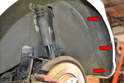 Begin by removing the three T25 Torx screws holding the lower rear wheel well liner to the bumper cover (red arrows).