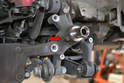You will need to remove the wheel speed sensor from the carrier (red arrow).