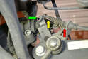 Remove the parking brake ball end (yellow arrow) and cable clip (red arrow) from the caliper.