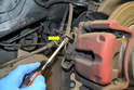 To remove the brake line from the caliper first use a flathead screwdriver and pry the brake line clip up and off the line (yellow arrow).