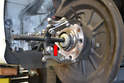 Reinsert the bolt back into the bearing carrier to use as a press point for the puller.
