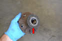 The bearing and hub should come right off as one piece (red arrow).