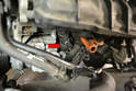 To replace the sensor on the thermostat pipe you must first remove the alternator.