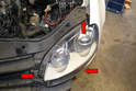 There are three T25 Torx screws holding the headlight assemblies in place (red arrows).