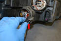 The turn signal (red arrow) bulb twists counter clockwise and pull out from the housing.
