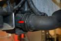 Disconnect the quick release from the lower left turbo pipe (red arrow) and separate the pipe from the intercooler.