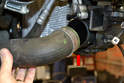 Disconnect the quick release from the lower right turbo pipe (red arrow) and separate the pipe from the intercooler.