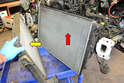 You can now separate the radiator (red arrow) from the intercooler (yellow arrow).