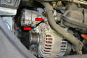 You will need to remove the alternator to gain access to the thermostat.