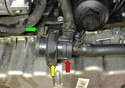 The pump (red arrow) is located on the lower front section of the engine in front of the oil pan.