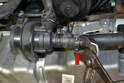 Begin by removing the clamp (red arrow) from the lower hose (red arrow).