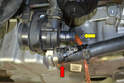 Coolant will escape from both the pump (yellow arrow) and hose (red arrow) once you separate them so be prepared.