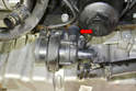 Remove the upper hose from the pump (red arrow).