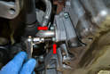 Remove the turbo lower oil line by removing the two 5mm Allen bolts (red arrows).
