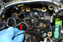 Remove the old gasket (red arrow).