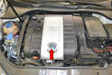 If you do not have an aftermarket air induction system that eliminates the engine cover (red arrow) you will need to remove the cover.