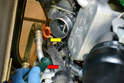 There is a series of hoses and wires that you will need to work around and through.