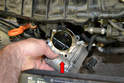 With the screws removed you can remove the throttle body out of the vehicle from the top (red arrow).