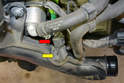 Disconnect the wiring connection (red arrow) from the boost sensor (yellow arrow).