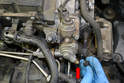 There is a Schrader valve located on the pump housing (red arrow).