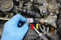 With the hose removed unclip the wiring harness (red arrow) from the sensor (yellow arrow) on the end of the fuel pump.
