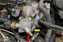 The Schrader valve (red arrow) blocks the lower T30 bolt on the pump (yellow arrow).