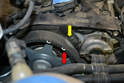 You need to turn the engine until the notch in the sprocket (red arrow) is even with the mark on the head (yellow arrow).