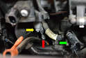 Disconnect the wiring harness for the fuel injectors (green arrow).