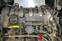 Disconnect the vacuum line from the manifold (red arrow) and the smaller line from the vacuum pump (yellow arrow) where they connect to the valve cover.