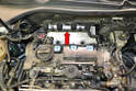 Disconnect the wiring harness from the coils and set it back out of the way (red arrow).