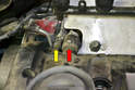 Remove the clamps for the two hoses on the rear of the valve cover.