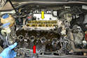 Wiggle and pull the valve cover (red arrow) until it separates from the head (yellow arrow).