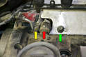 Disconnect the two vent hoses from the valve cover on the right side of the motor just above the turbo (red and yellow arrows).