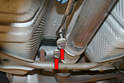 Loosen the two 13mm nuts holding the exhaust clamp (red arrows).