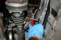 Use a 12mm triple square and remove the coolant line from the rear of the turbo (red arrow).