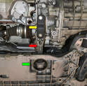 Remove the two 16mm bolts on the bracket (yellow arrow) and the 21mm bolt in the bushing (green arrow) and remove the dog bone (red arrow) from the vehicle.