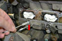 Clean the injector port with a Nylon brush (red arrow).