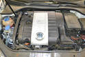 You will need to remove your engine cover or aftermarket air induction system.