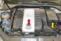 You will need to remove the engine cover (red arrow) or aftermarket air induction system first.