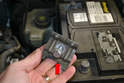 Make sure you place the plate and bolt (red arrow) in a safe place as you will need to reinstall it when replacing the battery.