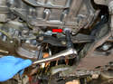 Use a 14mm Allen and remove the transmission drain plug (red arrow).