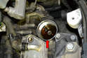 While the factory recommends buying their expensive tool and filling the transmission fluid from the bottom, you can clean the small amount of old fluid from the filter housing and then fill the transmission from the top.