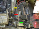 This photo illustrates the drop link (red arrow) that attaches the sway bar (green arrow) to a bracket on the strut (yellow arrow).