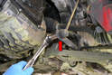 You will need to remove the link from where it attaches to the control arm with an 18mm socket or wrench (red arrow).