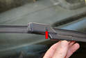 Lift the wiper arm and blade up off the windshield.