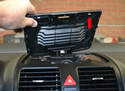 Center Vents - This photo illustrates the plastic clips that hold it in place (red arrow, one shown).
