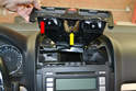 Center Vents - This will free the panel from the dash (red arrow).